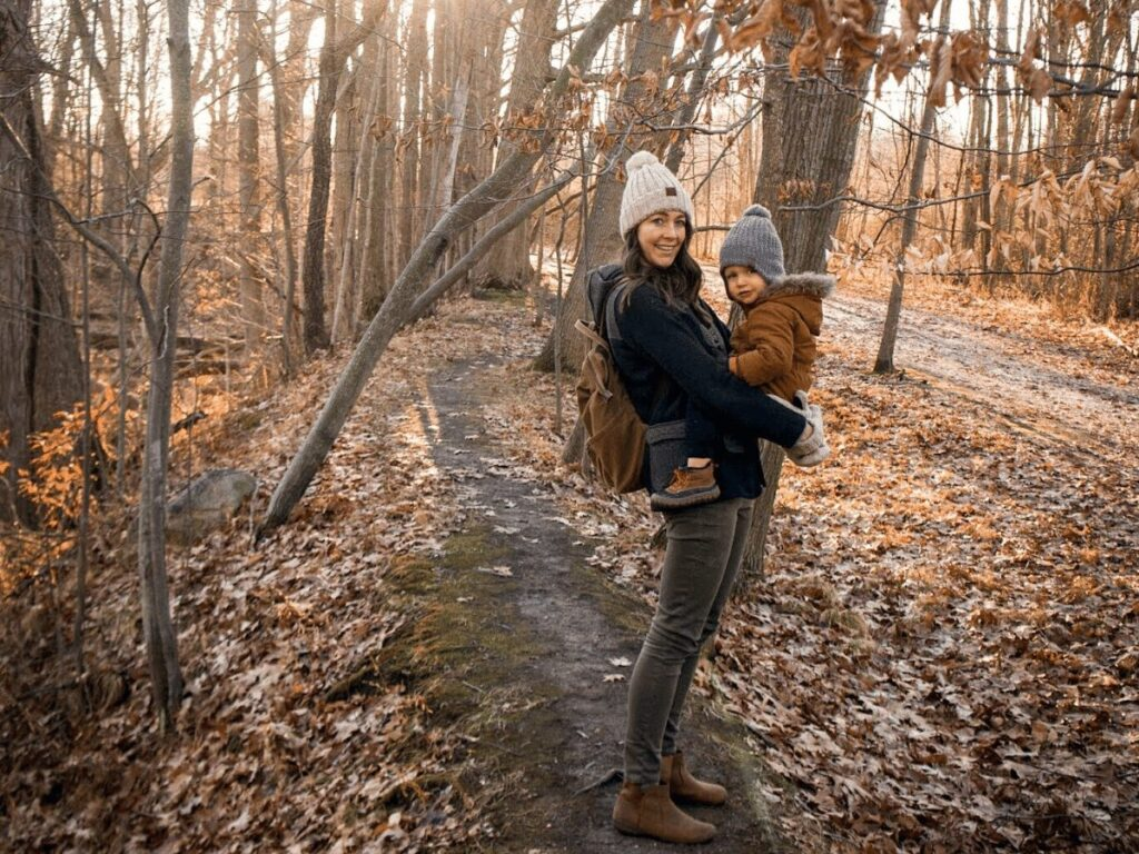 Mom holds small boy on hiking path: outdoor winter activities that don't require snow