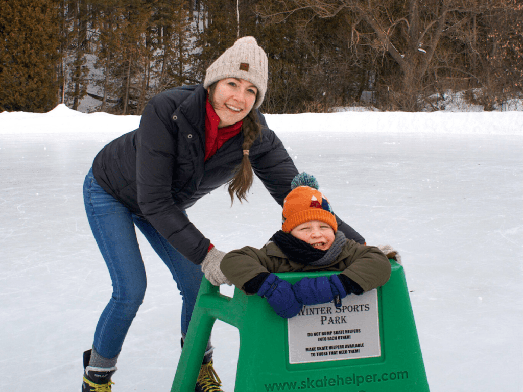Mom and small boy ice skating- family friendly outdoor activities in Petoskey michigan