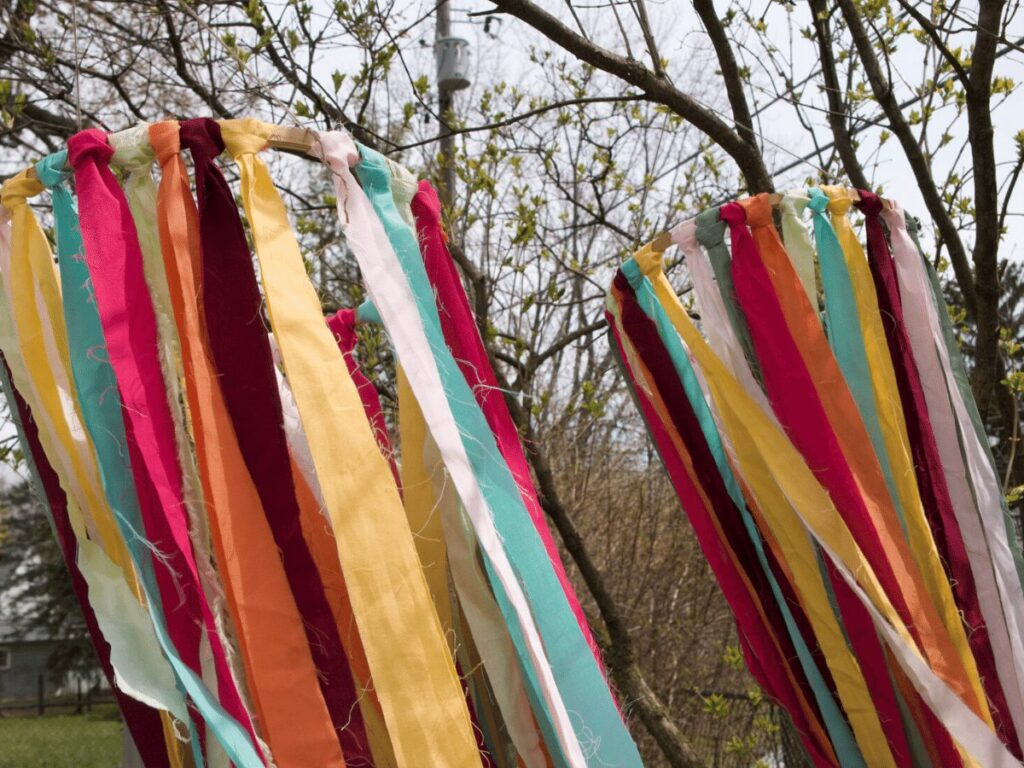 Ribbon decoration hanging from trees as part of May Day celebration.