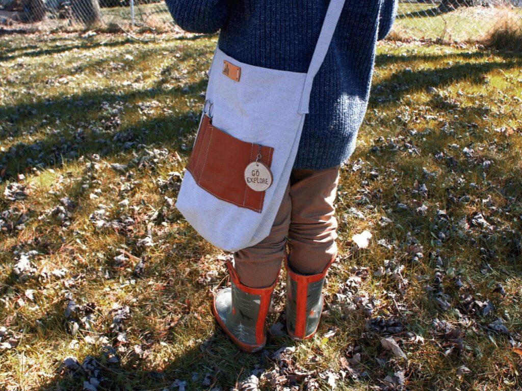 Boy wearing his nature explorer kit bag.