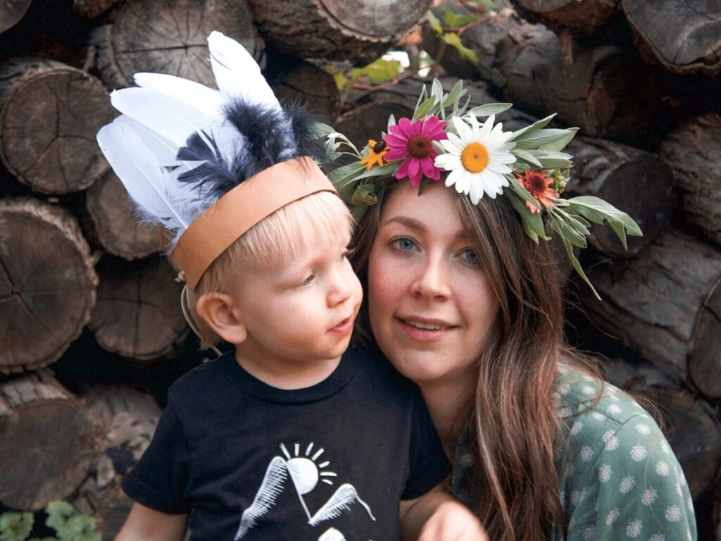 Mom and small boy wearing flower and feather nature crowns- summer bucket list