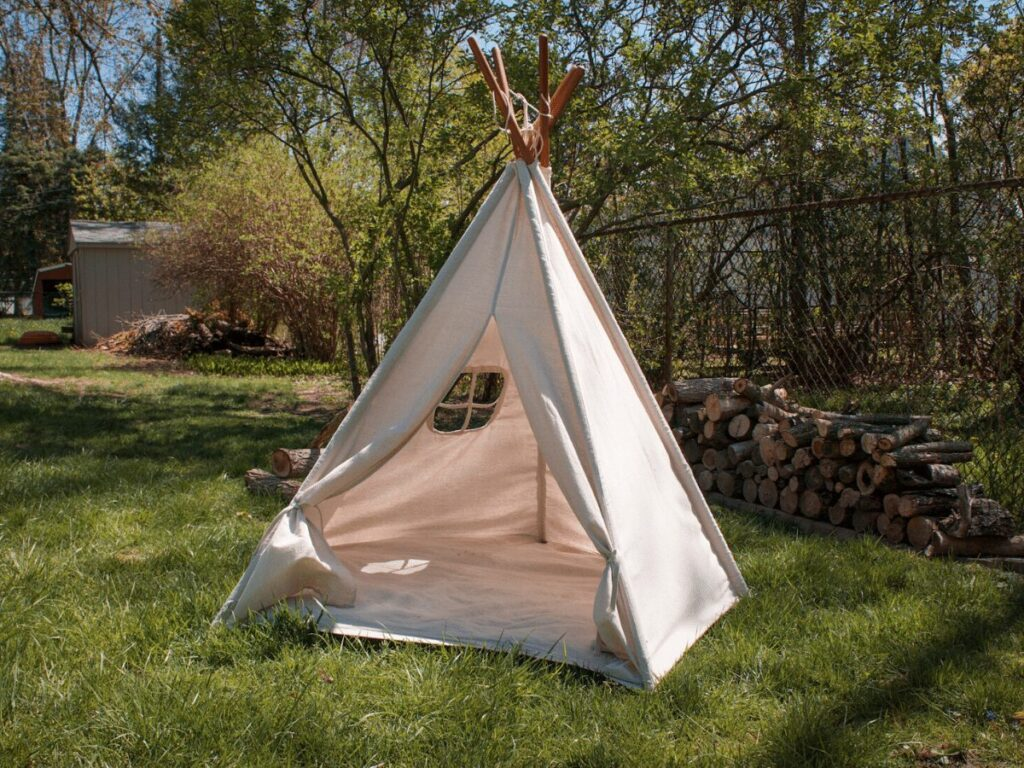 canvas teepee outside in backyad- best outdoor toys