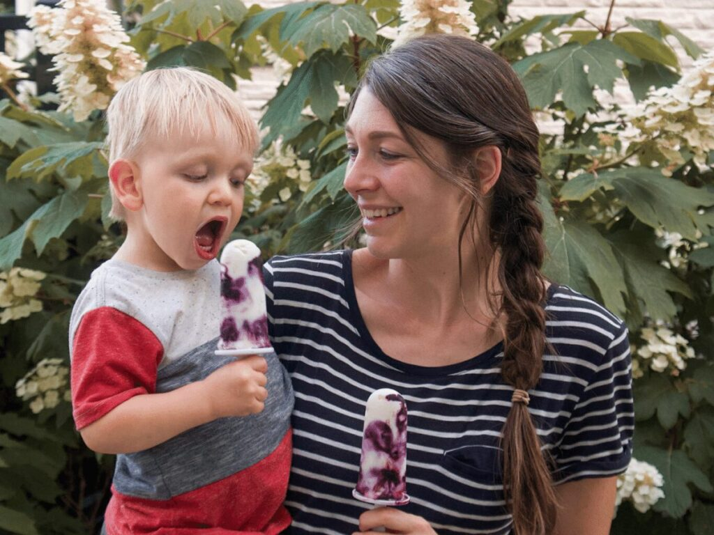 Mom and small boy eating popsicles- summer bucket list