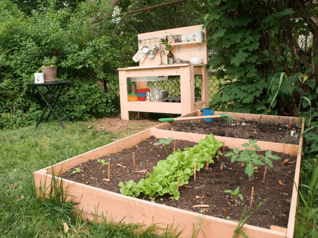 small garden in front of mud kitchen