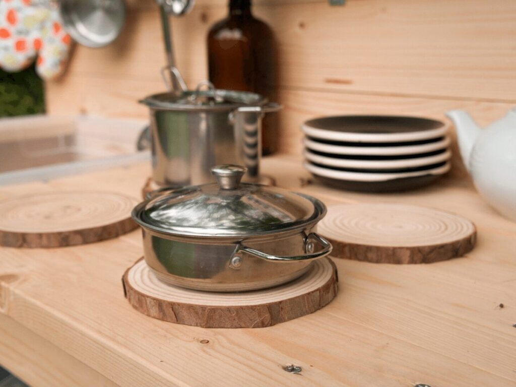close up of pot on mud kitchen play burners