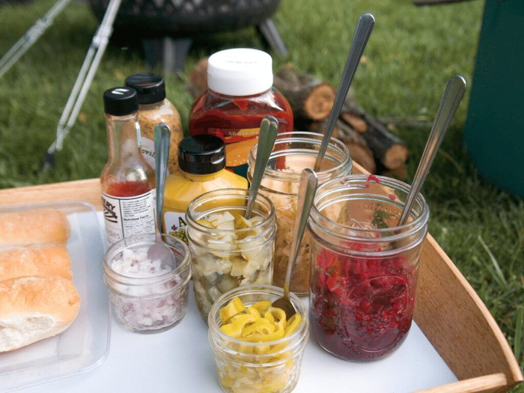 Array of condiments set out for campfire