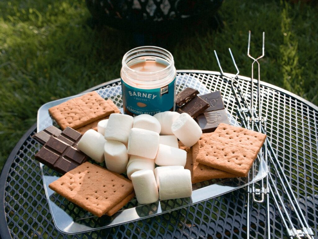 Platter of marshmallows, graham crackers, chocolate bars set out for campfire