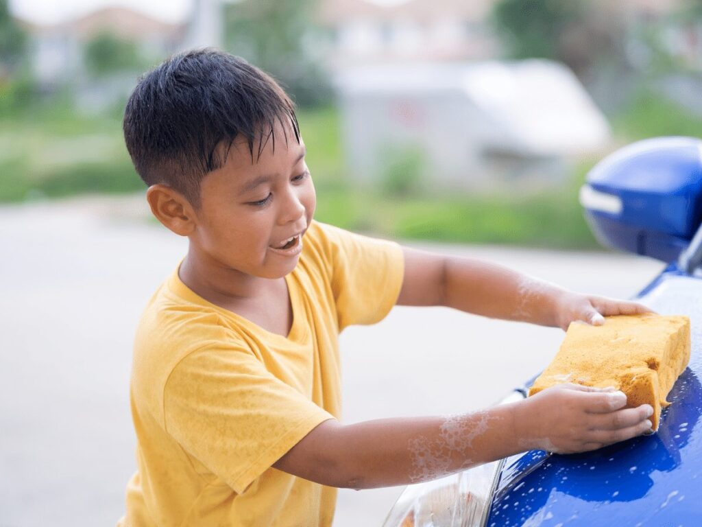 boy washes car- business ideas for kids