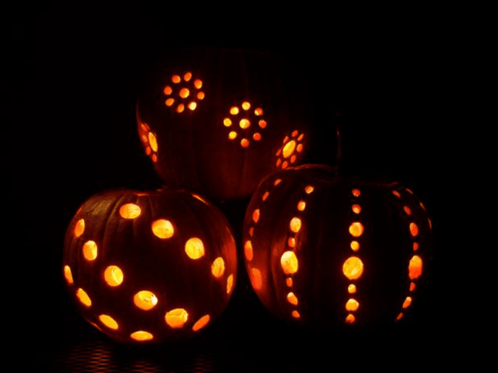 Pumpkins in the dark with holes drilled in them- pumpkin decorating ideas
