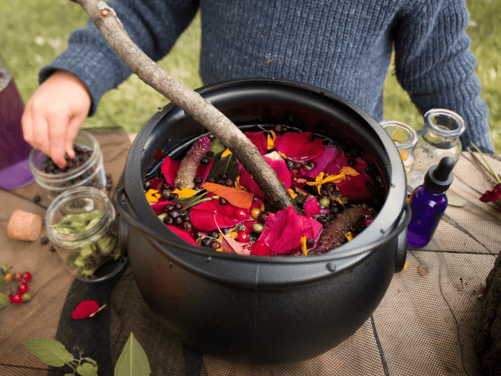 halloween activities for kids, cauldron filled with flower petals and other nature items