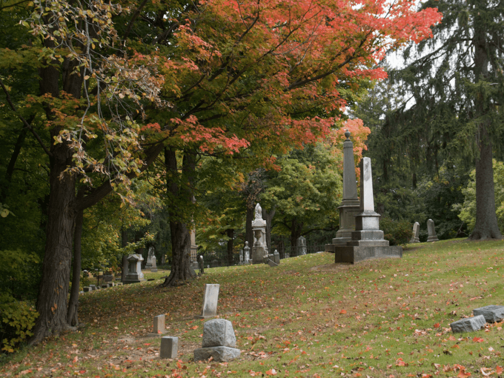 outdoor halloween activities, hilly old graveyard with colorful trees