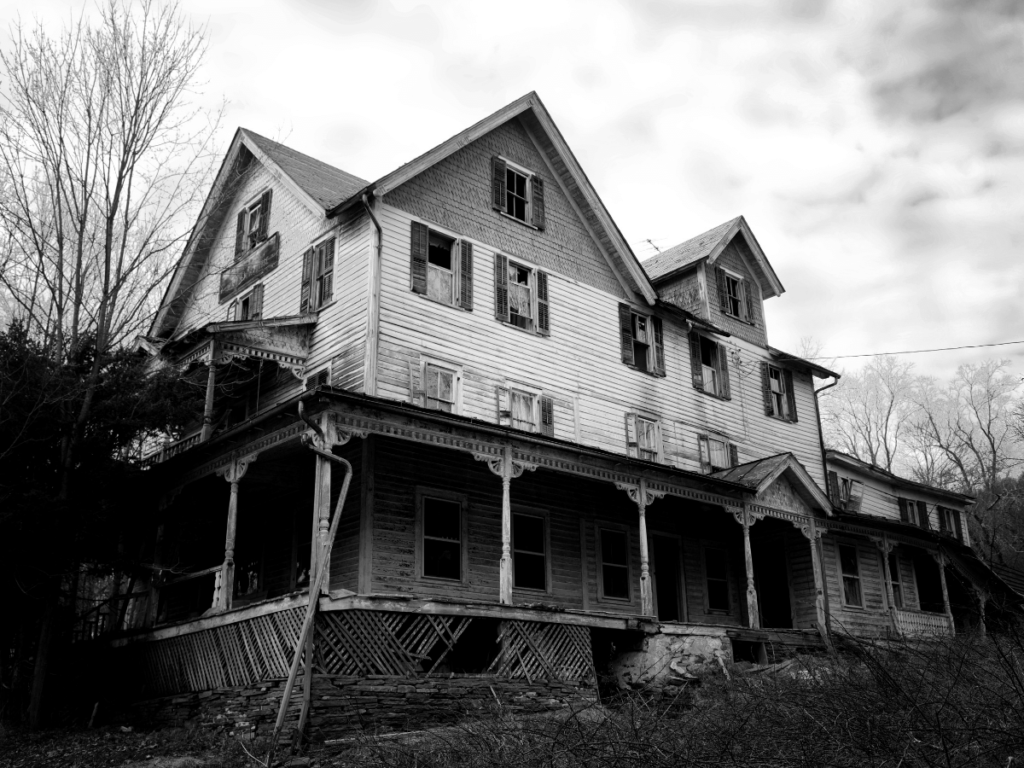 outdoor halloween activities, black and white picture of large dilapidated house