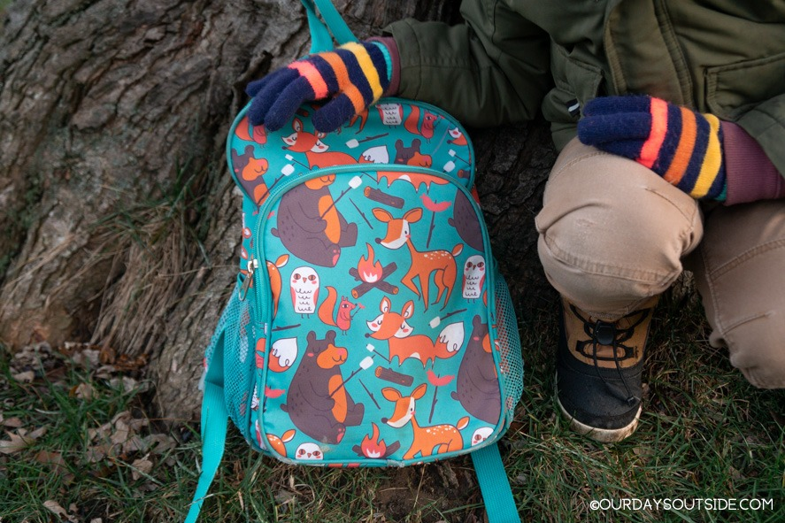 close up of kids backpack with forest animals- outdoorsy kids gift ideas