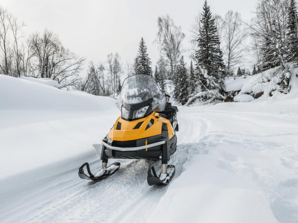 snowmobile on snowy path