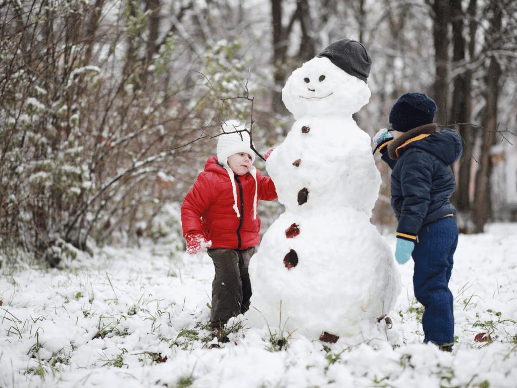 children building a snowman-outdoor winter activities