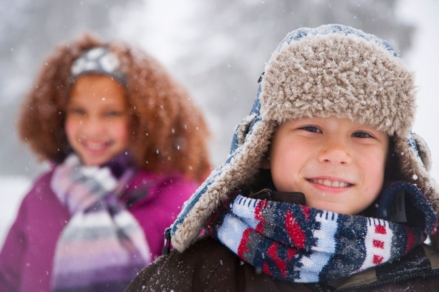 close up of child's face while bundled up outside in snow