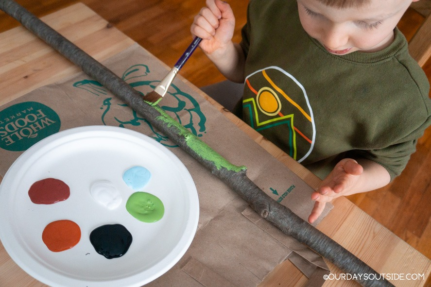 boy painting diy walking stick