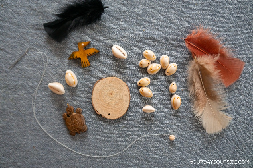 assortment of shells, beads, and feathers